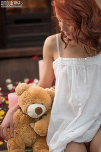 Sexy Redhead Teen Strips