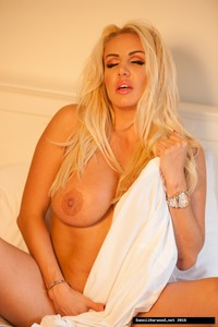 Beautiful MILF Dannii Harwood Stripping On A Bed