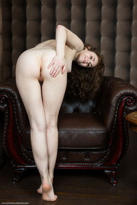 Estelle Spreads Her Wet And Shaved Pussy