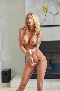 Busty Tattooed Blonde MILF Synthia