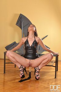 Latex Baby Plays With A Dildo