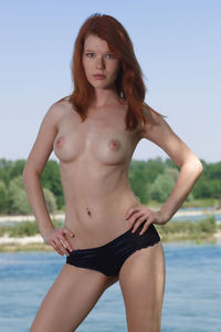 Sexy Redhead Cutie Showing Her Body