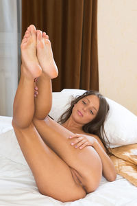Teenie Poes On Bed Naked