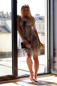 Standing In Her Window
