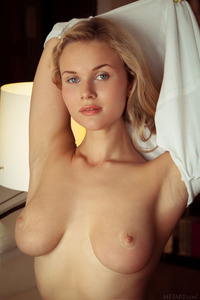 Tight blue jeans, white T-shirt, long blonde hair, blue eyes and big, round breasts - Caroline Abel