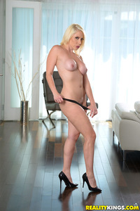 Busty MILF Sunny Strips And Poses Naked