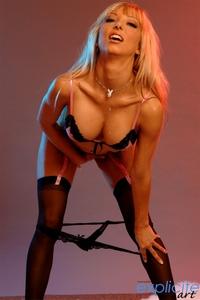 Megane blonde busty babe striptease