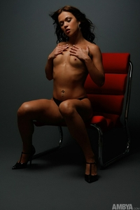 Model plays on a red chair