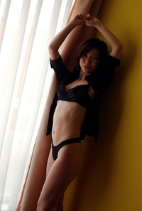 Sexy Japanese poses in her black lingerie