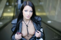 Sexy brunette strips on the street