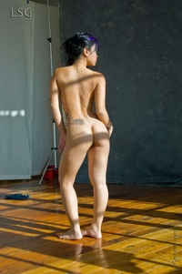 Super hot Asian bends over in the studio