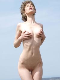 Sexy slim Abby posing outside