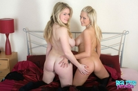 Big titted lesbians play with each other