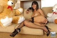 Thai babe Bua nude in stockings 00