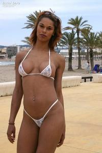 Pretty brunette in sexy blue bikini