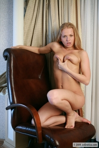 Anna feels horny on the chair