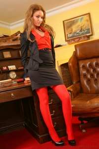 Strips out of her skirt suit and red stockings