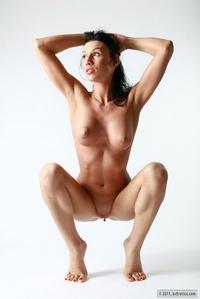 Busty brunette posing
