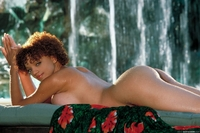Gia Lashay cools herself off at a waterfall