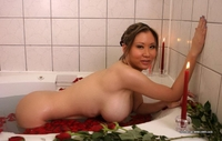 Heavy chested babe in bath tub
