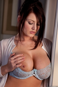 Sophie takes off her light blue top