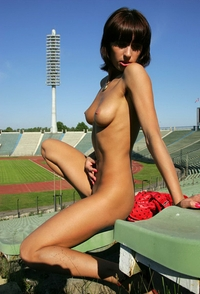 Horny babe posing in the stadion