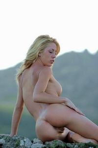 Blonde Aixa naked on the cliff
