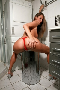 Big titted Eve naked in the washroom