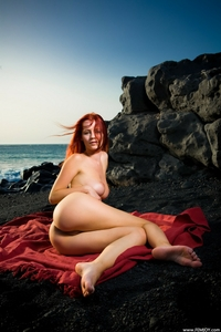 Sexy beach babe Ariel in the sunset