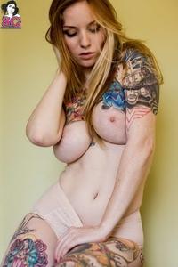 Tattooed redhead Kemper posing wild