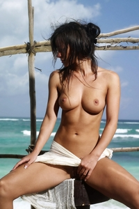 Gorgeous Melissa posing by the ocean