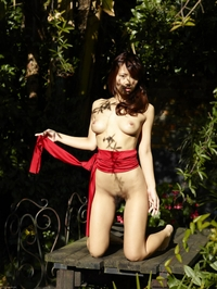 Young Asian Mayuko naked in the garden