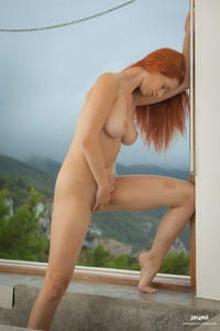 Red hot Ariel nude posing