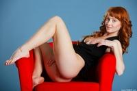 Cheeky redhead Ossana spreading legs