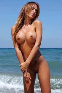 Beautiful Alexa naked on the shore