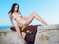Young Angie C teasing naked outdoor