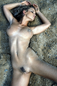 Sexy blonde babe naked on the beach