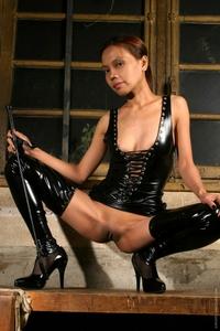 Wild Asian babe punishing in hot latex