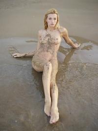 Dirty babe Coxy on the beach
