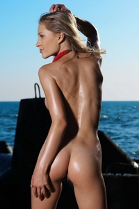 Sexy Candy naked posing by the ocean