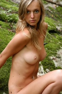 Gorgeous blonde Zina naked in the forest