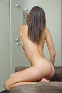 Cheeky young Nastya spreading legs