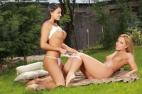 Naughty lesbian lovers play outside