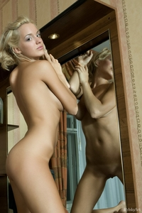 Cheeky blonde Nadezda spreading legs