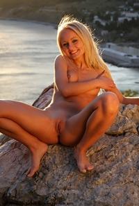Gorgeous blonde Elena posing outdoor