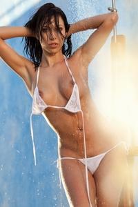 Gorgeous brunette Cydella posing