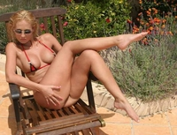 Blonde slut teasing in red tiny bikini