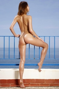 Gorgeous young Ksenia naked by the sea