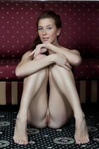 Young cutie Kira spreading legs