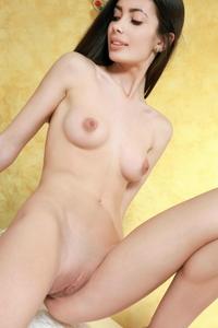 Young virgin Flora posing naked
